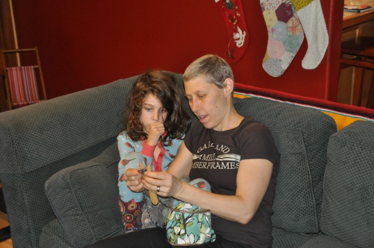 Taylor and Mommy knitting on Christmas morning